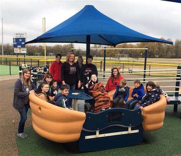 CJ Students enjoy the all-inclusive playground at the Miracle Field.